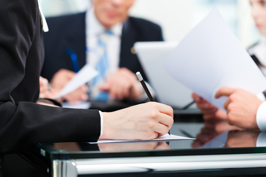 Business - meeting in an office, lawyers or attorneys discussing