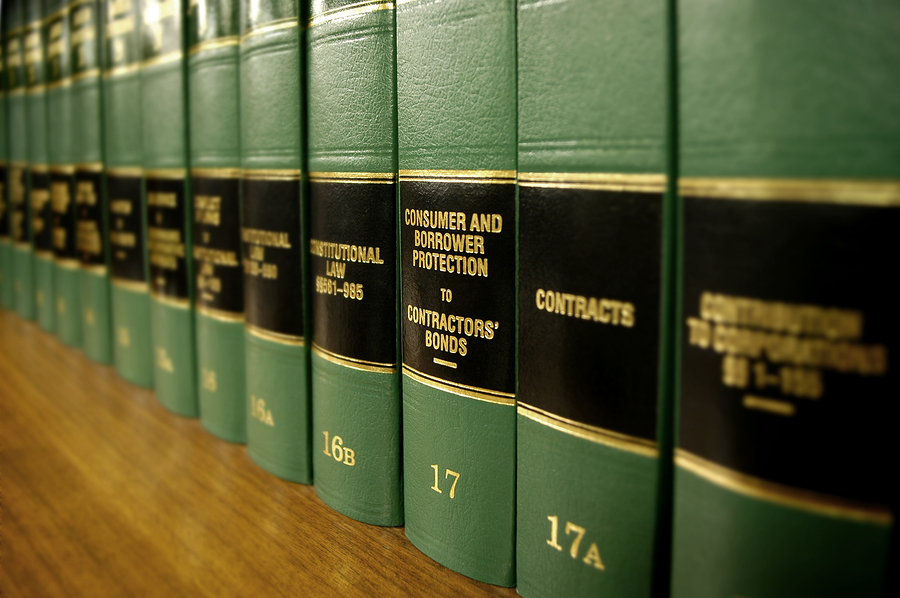 Close up of several volumes of law books of codes and statutes o
